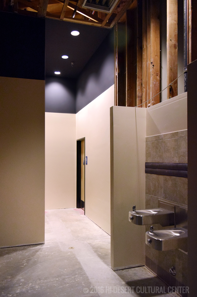 New hallway to ADA compliant patron restrooms and drinking fountains: the women's and men's restrooms had to be completely flipped and relocated to accommodate the new building codes.