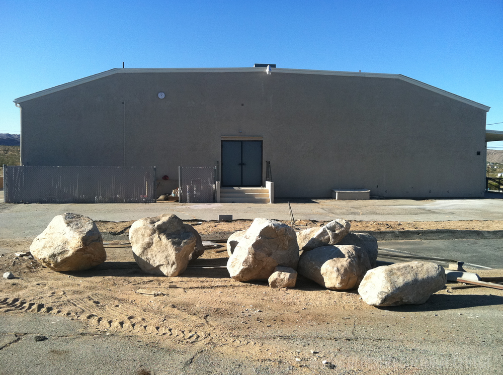 Large boulders waiting to be placed in front of the Cultural Center as part of the landscape design for its water-wise garden.
