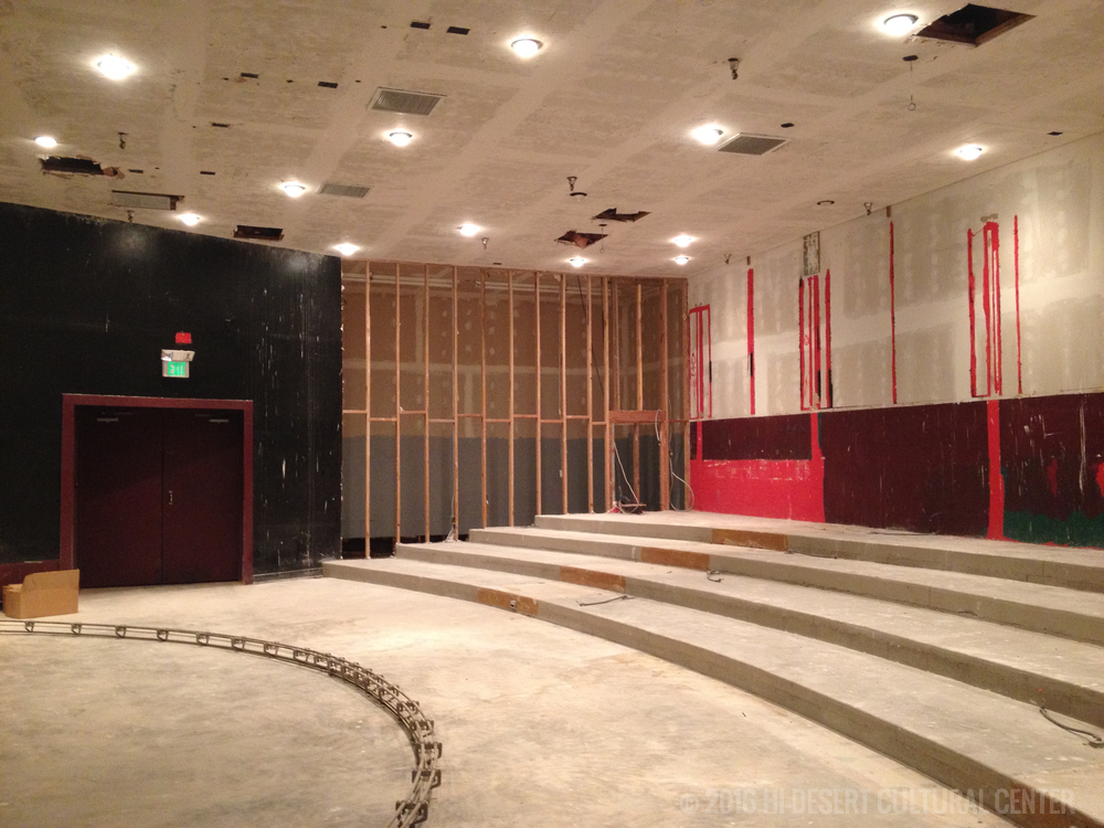 Orchestra seating area after partial demo.  Exposed studs reveal seating expansion.