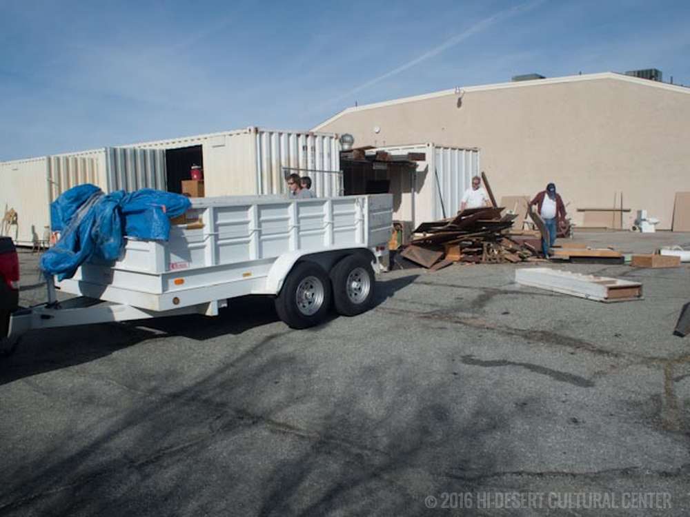 Sorting through and removing damaged, broken, and discarded old set and prop pieces that had been stored in cargo containers and strewn in large piles throughout the property.  It took several 40-yard roll-offs and countless trips to the local dump to finally clean-up the property surrounding the theaters.
