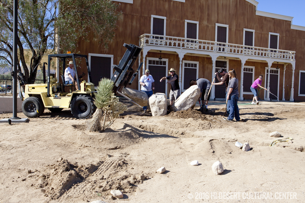 Installing large boulders in front of the Cultural Center as part of the landscape design for its water-wise garden.