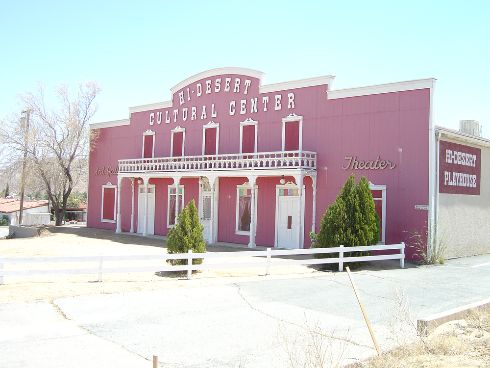 Prior to the new administration: With missing windows and paintballs having been shot at its façade, the Hi-Desert Cultural Center's original exterior had long since faded to pink.  While the Center's façade has already now been repainted, it will soon be completely rebuilt using real wood, stone and wrought iron accents, and stunning halo lit signage — all while beautifully preserving its historic front porch.