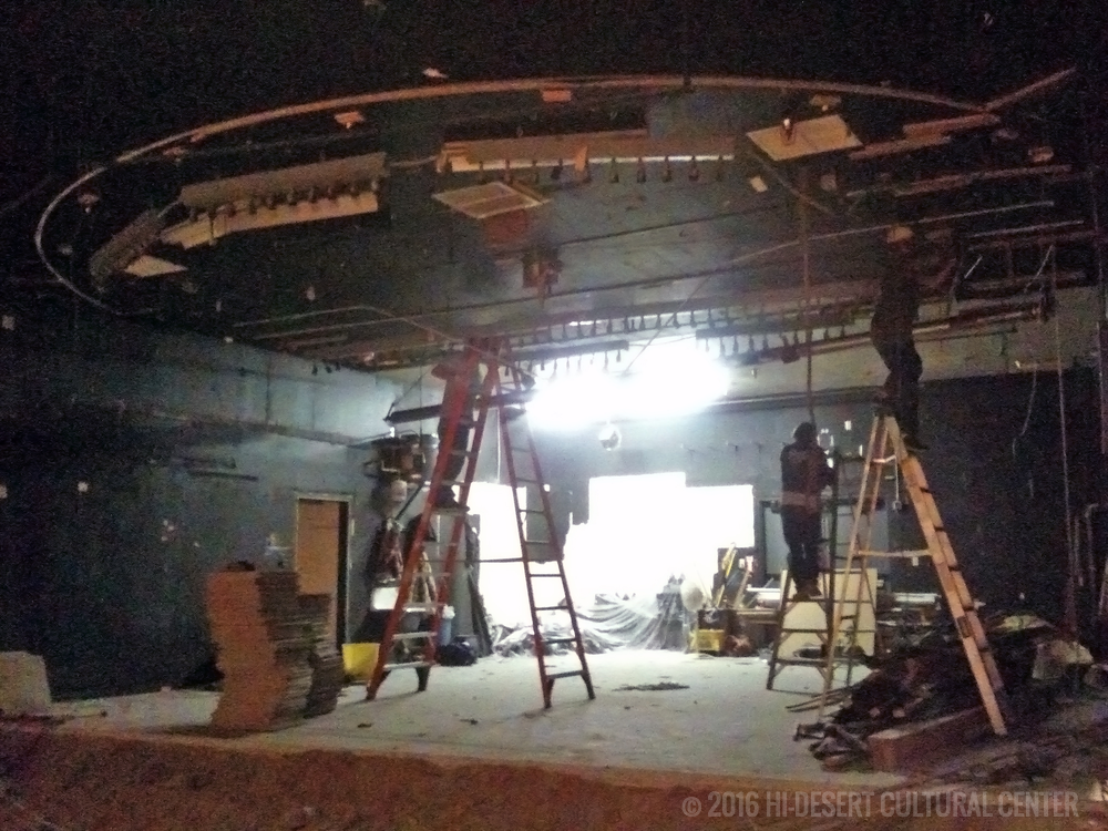 Removing old lighting and electrical above stage.