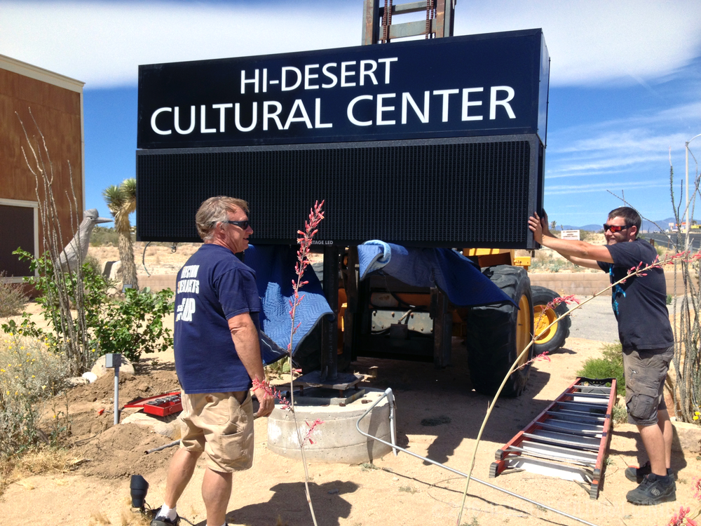 Installing the Cultural Center's new full-color led marquee on Highway 62.